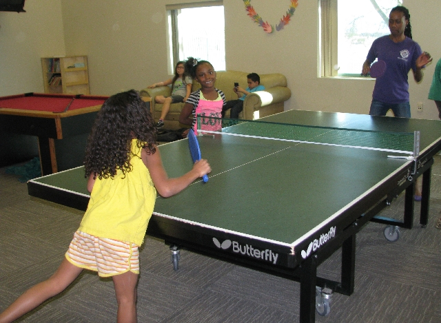 Program assistant Carlinda Ford instructs after-school program participant Sofia Galleo in table tennis techniques March 14 at the Hollywood Recreation Center, 1650 S. Hollywood Blvd. The center i ...