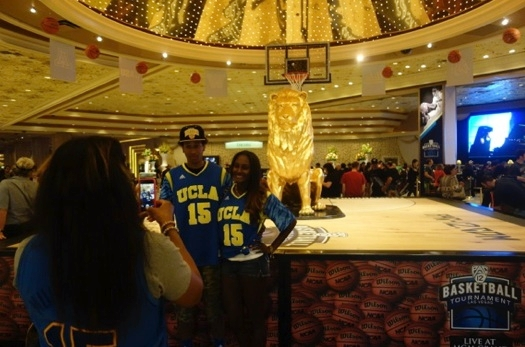 Faye Muhammad, mother of UCLA star Shabazz Muhammad, photographs her son Rashad and daughter Asia on Thursday in the MGM Grand lobby.