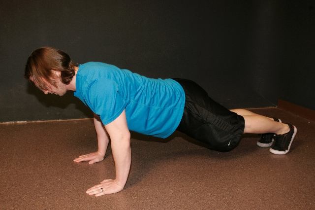 CLAPPING PUSHUPS, START: Begin in pushup position, the back straight, core tight and head neutral. Place the hands on the floor with the fingers pointing forward directly under the shoul ...