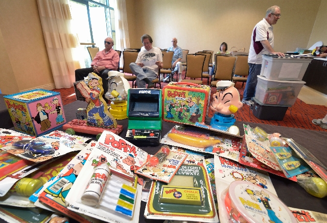 Patti Barth brought containers of Popeye toys and memorabilia: bubbles, a Popeye shaving kit (for kids), a Popeye comb, a tambourine, a lunchbox, electronic game, and dozens of other games and toy ...