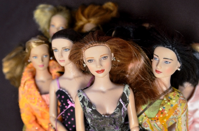 Dolls were among the many items that turned up at the FX Toy-Buying Roadshow. Though these dolls have their heads, Joel Magee, the show's host, says some that he buys at toy shows are missin ...