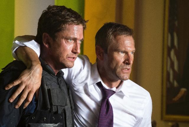 "Secret Service leader Mike Banning (Gerard Butler, left) protects President Benjamin Asher (Aaron Eckhart) in ""Olympus Has Fallen."""