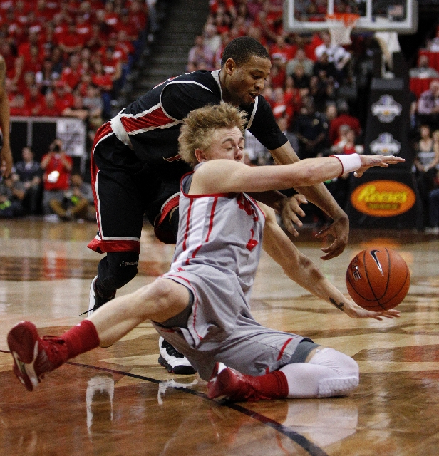 Hugh Greenwood of New Mexico tries to steal the ball from Bryce Dejean-Jones during the Mountain West tournament championship at the Thomas & Mack Center on Saturday.