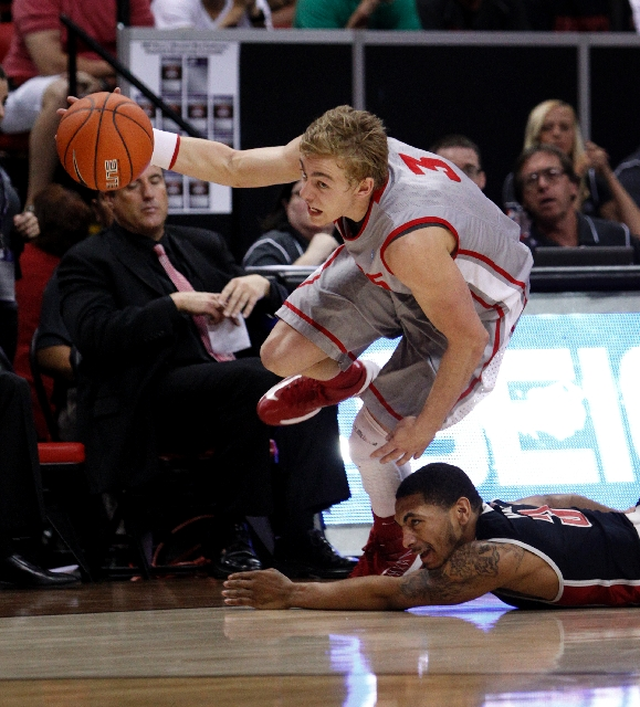 New Mexico sophomore point guard Hugh Greenwood strips the ball from UNLV senior point guard Anthony Marshall during the Mountain West tournament championship Saturday at the Thomas & Mack Center. ...