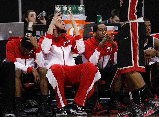 UNLV players on the bench react as they trail near the end of the Mountain West tournament championship at the Thomas & Mack Center on Saturday.