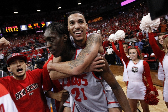New Mexico guard Kendall Williams rides on the back of teammate Tony Snell after the Lobos' 63-56 win over UNLV on Saturday in the Mountain West tournament final. Snell scored 21 points and  ...
