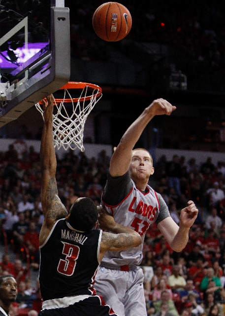 Anthony Marshall of UNLV goes up for a shot agsint Alex Kirk of New Mexico during the Mountain West tournament championship at the Thomas & Mack Center on Saturday.