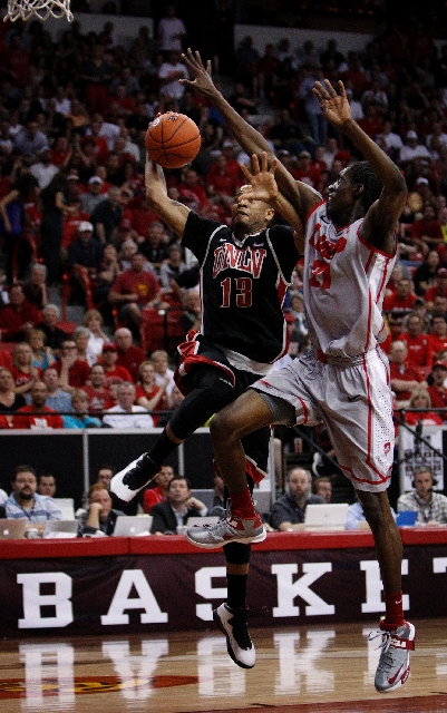 Bryce Dejean-Jones of UNLV goes up for a shot against Tony Snell of New Mexico. Dejean-Jones scored 19 points and brought down seven rebounds in the Rebels' loss in Mountain West tournament  ...
