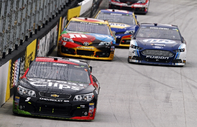 Eventual winner Kasey Kahne leads the NASCAR Sprint Cup Series race in his Hendrick Motorsports Chevrolet on Sunday at Bristol Motor Speedway in Bristol, Tenn. Kahne is trailed by eventual runner- ...