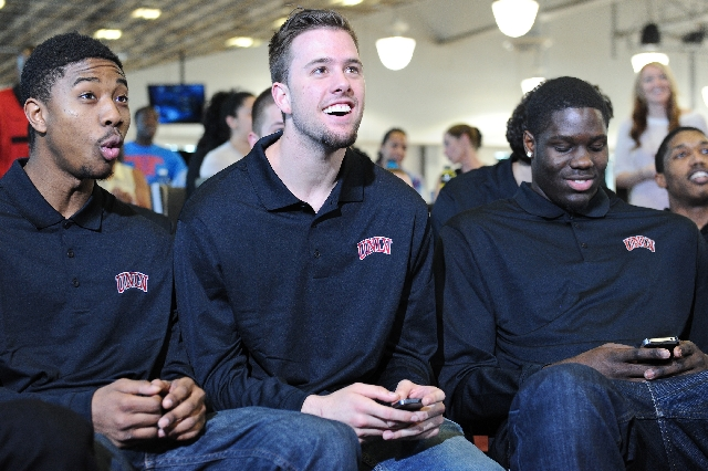 UNLV basketball players, from left, Daquan Cook, Katin Reinhardt and Anthony Bennett watch the NCAA Tournament selection show Sunday at the Mendenhall Center. The Rebels received a No. 5 seed and  ...