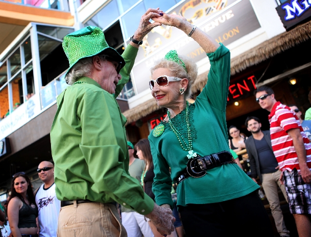 Suzanne Bugg dances with husband Larry Whelan at the Fremont Street Experience on Sunday, St. Patrick's Day. The Las Vegas couple have been married for 50 years. The Fremont Street Experienc ...