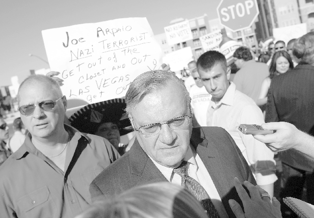 Sheriff Joe Arpaio speaks with reporters on Las Vegas Boulevard in May 2010. Arpaio broke his shoulder on Feb. 28 when he fell while crossing a streeet. He is eager to return to work today after s ...
