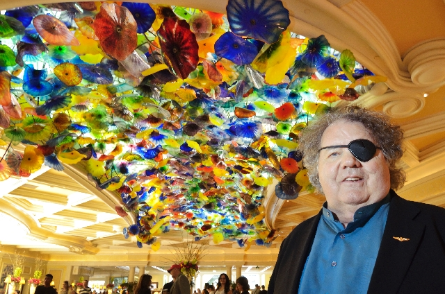 """Artist Dale Chihuly stands beneath one of his most famous pieces, """"Fiori Di Como,"""" in the lobby of Bellagio."""