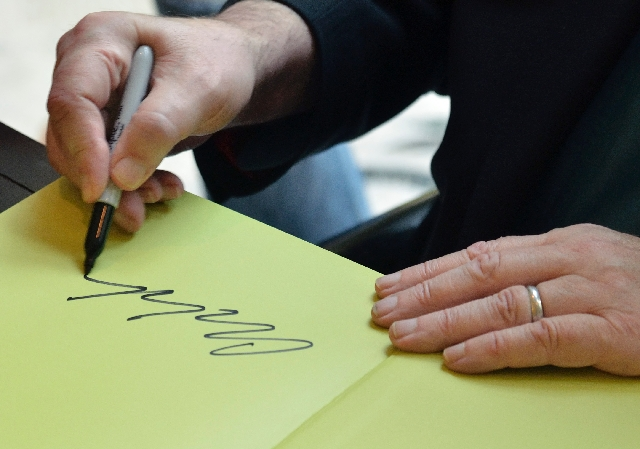 """Dale Chihuly autographs copies of his new book, """"Chihuly Silvered."""""""