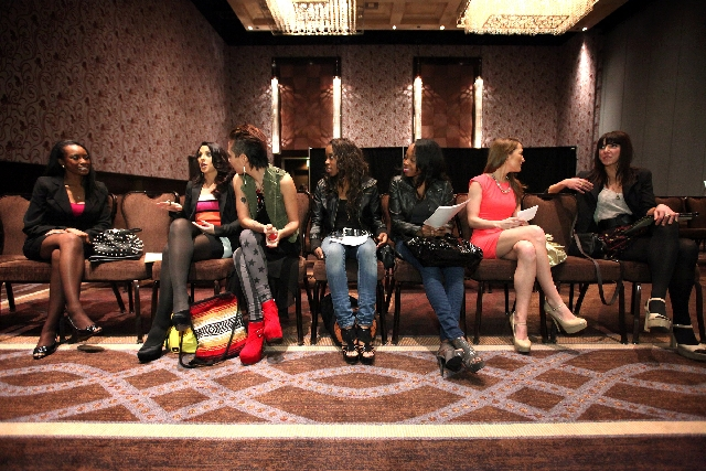 Job applicants chat among  themselves while waiting for one-on-one interviews at  The Cosmopolitan of Las Vegas on Jan. 23. The Cosmopolitan was hosting auditions for  200 open positions during th ...