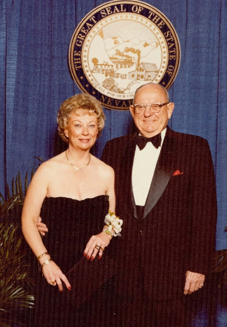 Dorothy Huffey and her father, retired Adm. Jack Howell, posed for a photo at Gov. Richard Bryan's inaugural ball. Behind them is the state seal that Howell's father designed.