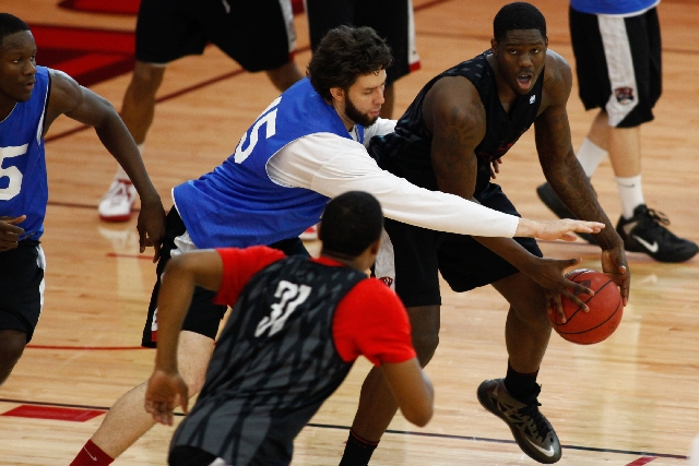 UNLV junior forward Carlos Lopez-Sosa, top left, applies defensive pressure against Anthony Bennett during Rebels practice Monday at the Mendenhall Center. Lopez-Sosa's playing time fell to  ...