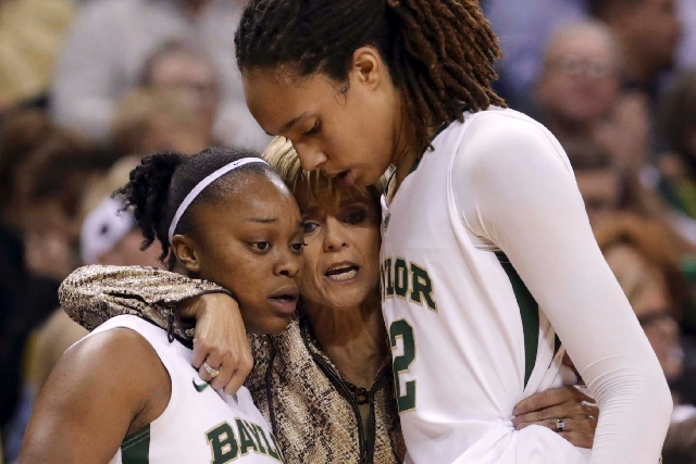 Baylor head coach Kim Mulkey, center, hugs Brittney Griner (42) and Odyssey Sims (0) after the players were pulled late in the second half of their NCAA college basketball game against Tennessee i ...