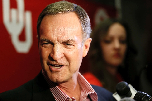 Oklahoma head coach Lon Kruger addresses reporters after learning their NCAA college basketball tournament assignment during a Selection Sunday viewing party in Norman, Okla. on Sunday.