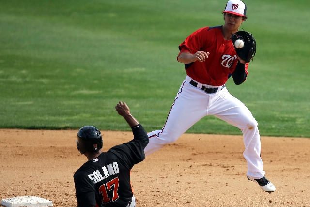 Washington Nationals shortstop Zach Walters, right, from Las Vegas fields a relay while Donovan Solano of the Miami Marlins steals second base during an exhibition Feb. 27 at Viera, Fla. The 23-ye ...