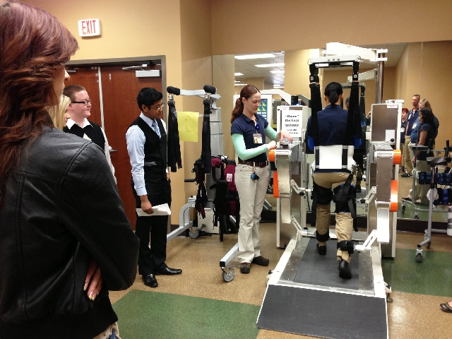 Foothill High School students watch a demonstration of a paralysis machine at Health South Desert Canyon during National Job Shadow Day.