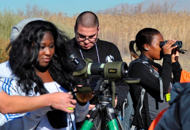 Students from Western High School view wildlife with Bureau of Reclamation staff during a National Job Shadow Day experience.