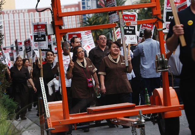 In an act of civil disobedience, members of the Culinary Union march on the Las Vegas Strip in front of the Cosmopolitan Hotel during a planned protest on Wednesday.