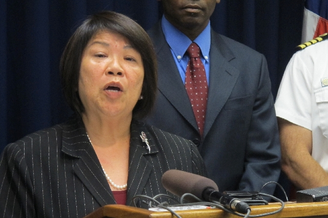 U.S. Attorney Florence Nakakuni speaks at a news conference in Honolulu on March 18 to announce authorities have charged a U.S. Pacific Command defense contractor with giving defense secrets to a  ...
