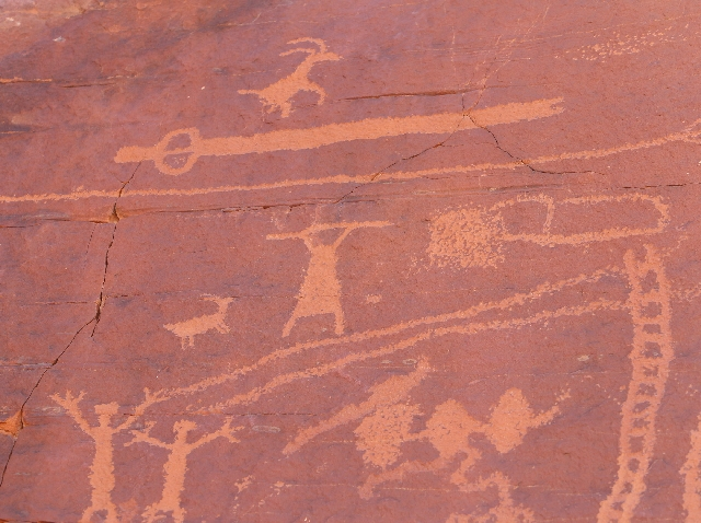 Petroglyphs show a hunter using an atlatl to hunt bighorn sheep at Valley of Fire State Park. An atlatl is seen above the hunter that is shown. Hunters from the vanished Anasazi tribe etched the r ...