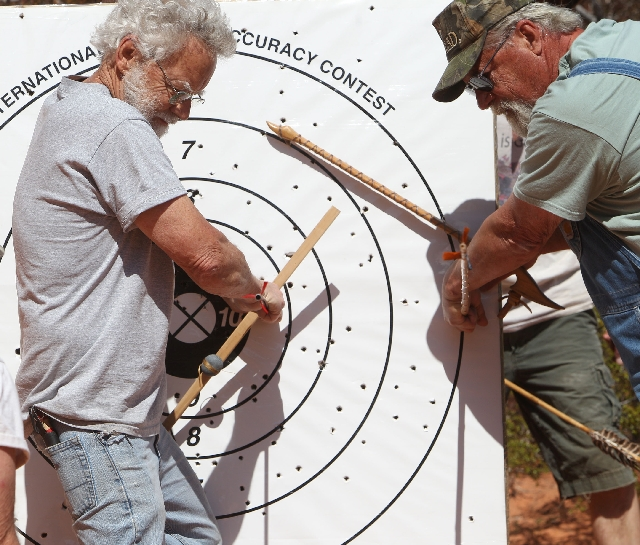 Roy Madden, left, of Joplin, Mo., and Derek Brockway, of Las Vegas, pull their darts from a target while competing with atlatls during demonstration day Friday at the 22nd annual World Atlatl Cont ...