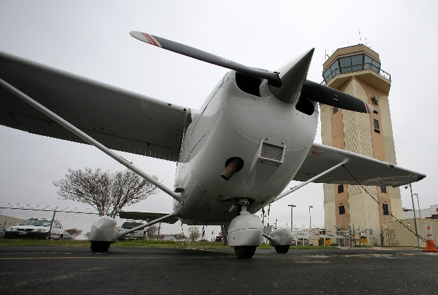 A Cessna aircraft is parked Friday by the air traffic control tower at the Collin County Regional Airport in McKinney, Texas. Congress approved legislation last week to fund the federal government ...
