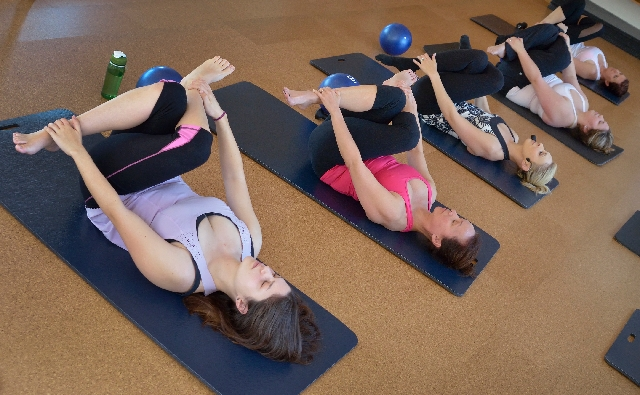Kim Dorfman, left, participates in a class at barre3 studio at 120 S. Green Valley Parkway in The District at Green Valley Ranch in Henderson.