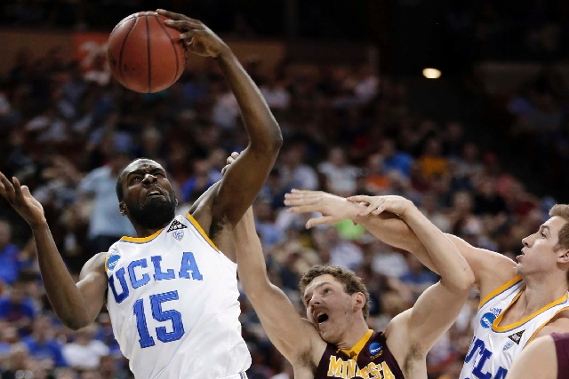 Minnesota's Oto Osenieks reaches for a rebound with UCLA's Shabazz Muhammad (15) and David Wear (12) during the first half of a second-round game of the NCAA tournament Friday in Austi ...