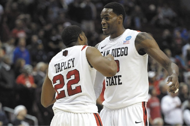 San Diego State guard Chase Tapley and forward Deshawn Stephens celebrate in the final minutes of the Aztecs' 70-55 win over Oklahoma on Friday night in Philadelphia.