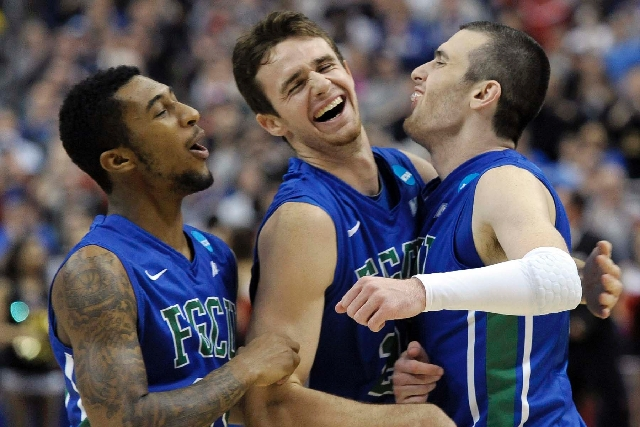 Florida Gulf Coast's Dajuan Graf, from left, Eddie Murray and Brett Comer celebrate after winning a third-round game against San Diego State in the NCAA tournament Sunday in Philadelphia. Fl ...