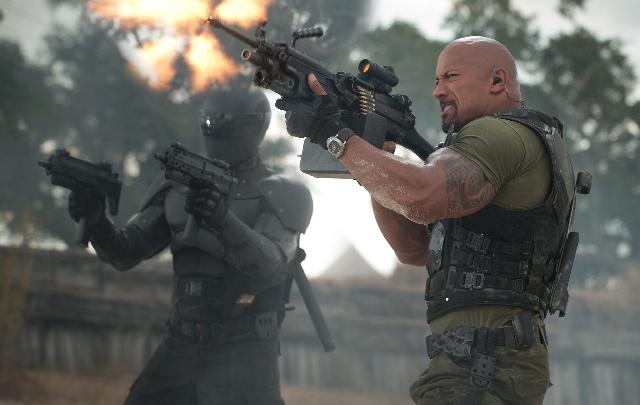 "Snake Eyes (Ray Park), left, and Roadblock (Dwayne Johnson) break out the heavy artillery in ""G.I. Joe: Retaliation."""