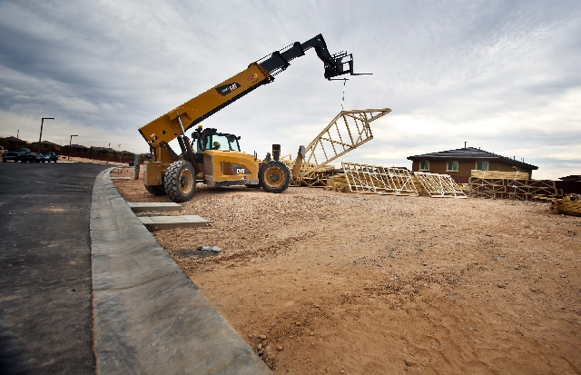 Construction as seen Tuesday at Terraza Amado homes at The Mesa village in Summerlin. Units in the Pulte Homes development range from 2,100 to 2,575 square feet and are selling in high $200,000s.  ...