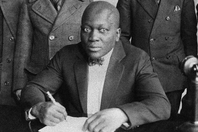 Boxer Jack Johnson is shown signing contracts in this undated photo. A resolution seeking a presidential pardon for Johnson passed a state Senate committee on Tuesday. Johnson, who died in 1946, w ...