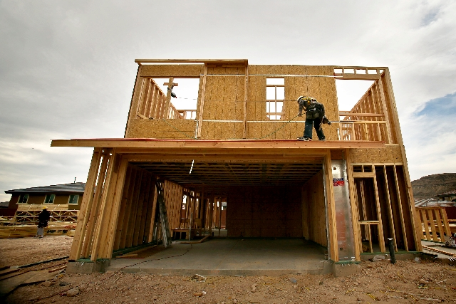 A framer works Tuesday on the Terraza Amado project at The Mesa village in Summerlin. The latest Standard and Poor's Case-Shiller Home Price Index shows home prices rising nationwide and in  ...