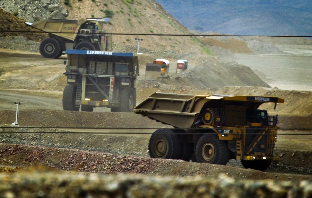 Trucks at the Cortez mine carry loads out of the mine on Aug. 7. Most Senate Republicans have pledged to increase mining taxes.