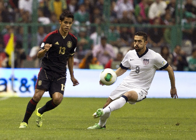 United States forward Herculez Gomez, right, a Las Vegas High School product, and Mexico defender Severo Meza vie for the ball Tuesday during a World Cup qualifying match at Azteca Stadium in Mexi ...