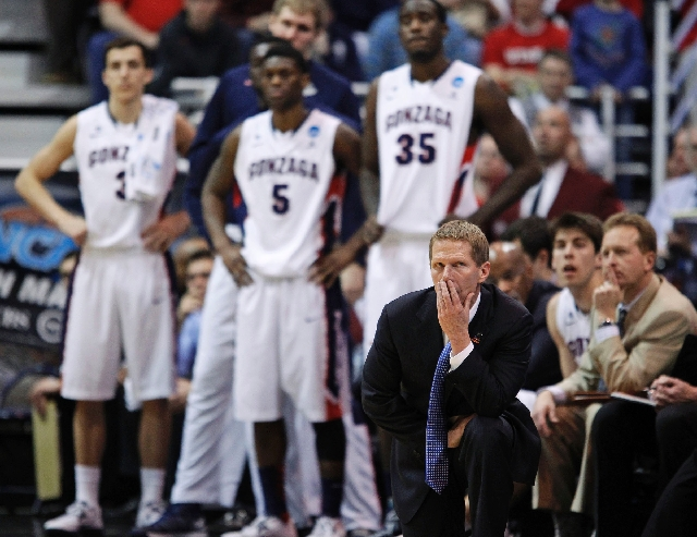 Gonzaga coach Mark Few glances up at the scoreboard late in the second half of a third-round game in the NCAA tournament in Salt Lake City on Saturday, March 23. Gonzaga lost to Wichita State, 76-70.