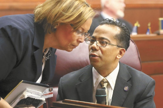 Assemblyman Steven Brooks, D-North Las Vegas, talks with his attache Robin Carter on Feb. 6 on the Assembly floor. He was expelled from the Assembly on Thursday.