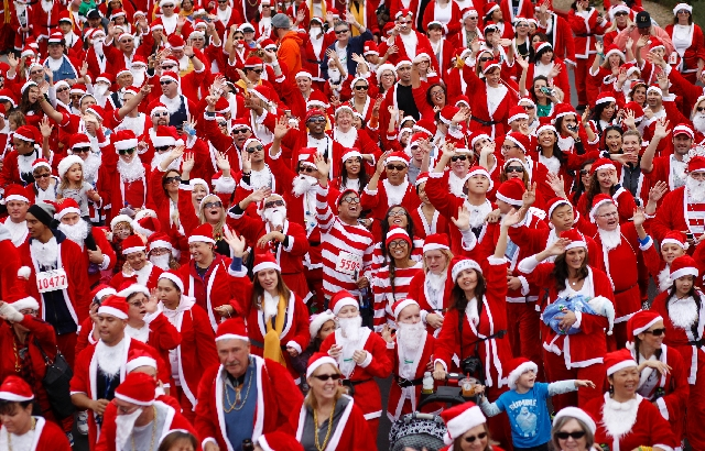 People start the Great Santa Run on Dec. 1 at Town Square. Opportunity Village officials said Thursday that the event will move back to downtown Las Vegas.