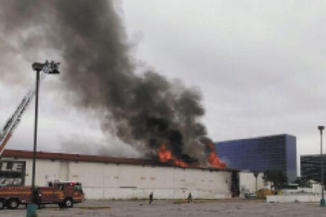 Flames shoot from the closed Key Largo casino on Flamingo Road near Paradise Road Thursday afternoon.