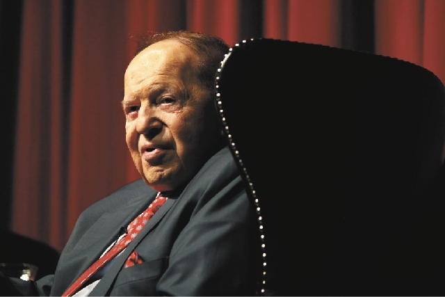 Las Vegas Sands Chairman and CEO Sheldon Adelson, shown speaking to UNLV students in this 2012 photo,  seeks to bar cameras from next week's trial.