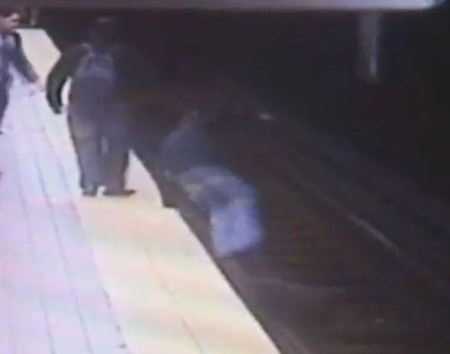 In this still image taken from security video provided by the Southeastern Pennsylvania Transportation Authority (SEPTA), Christopher Knafelc jumps off a subway platform in north Philadelphia to h ...