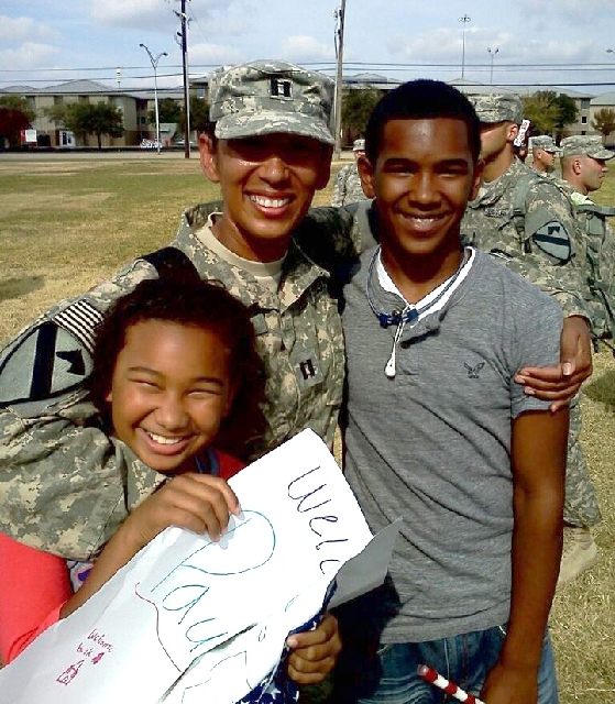 """Capt. Paula Birch  is reunited with daughter Paige  and son Jalen after returning from deployment. """"I think she is a good asset to Las Vegas,"""" her commander, Lt. Col. Bryan C. Seay sai ..."""