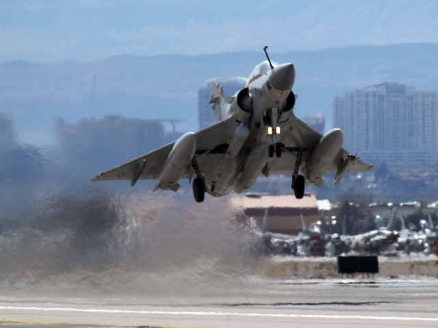 A Mirage jet from the United Arab Emirates takes off at Nellis Air Force Base as part of Green Flag exercises Feb. 27. More than 100 aircraft from the United States, Great Britain and Australia pa ...