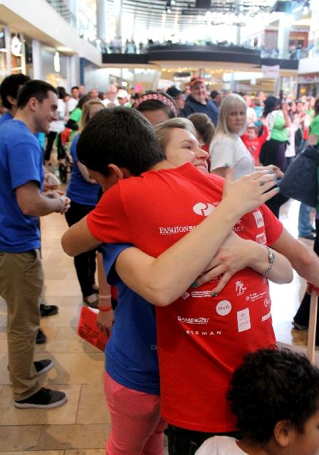 Eldorado High School senior Brandon Jacobs hugs Katherine Currie-Diamond at the Walk with the Heart of a Child event.